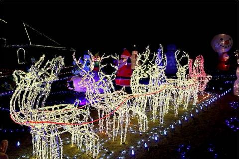Photos by Britne Hammons                                Reindeer and Santa's sleigh are ready for takeoff from Howard Bell's light show.